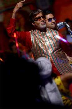 Amitabh Bachchan and Abhishek Bachchan in a dance sequence from the film Bol Bachchan, an upcoming Bollywood romantic comedy film directed by Rohit Shetty. Bollywood release: Bol Bachchan
