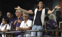 Bollywood actor Shah Rukh Khan, co-owner of Kolkata Knight Riders aplauds as he watches an Indian Premier League (IPL) cricket match against Chennai Super Kings in Kolkata. HT Photo/Subhendu Ghosh CSK topple KKR