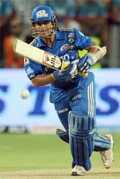 Mumbai Indians batsman Sachin Tendulkar plays a shot during the IPL 5 cricket match between Pune Warriors and Mumbai Indians in Pune. AFP Photo/Indranil Mukherjee Mumbai Indians beat Pune Warriors