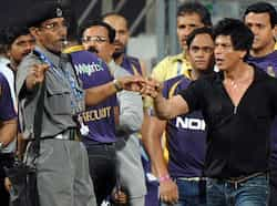 Bollywood actor and Indian Premier League franchise Kolkata Knight Riders co-owner Shah Rukh Khan gestures towards a security guard blowing a whistle to direct children accompanying him off the playing field after the IPL Twenty20 cricket match between Mumbai Indians and Kolkata Knight Riders at The Wankhede Stadium in Mumbai.  AFP/Indranil MUKHERJEE SRK off the handle