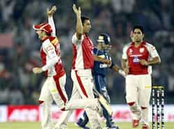 Azar Mahmood players of Kings XI Punjab bowler celebrates with other players after dismissal of Parthiv Patel of Deccan Chargers during the IPL Twenty 20 cricket match at PCA Stadium, Mohali, Gurpreet Singh/HT KXIP beat DC