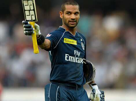 Deccan Chargers batsman Shikar Dhawan raises his bat  as he walks back to the pavillion after being dimissed for 84 runs during the IPL Twenty20 cricket match in Hyderabad. (AFP Photo/Noah Seelam) Delhi thrash Deccan