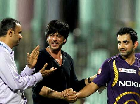 Kolkata Knight Riders owner Shah Rukh Khan greets his team skipper Gautam Gambhir after winning over Chennai Super Kings in the IPL5 match at MAC Stadium in Chennai. PTI/R Senthil Kumar KKR beat Chennai