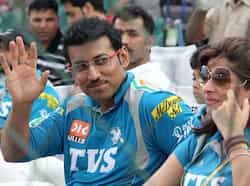 Rajasthan Royal supporter and Olympic medal winner  Rajyavardhan Rathore waves during the IPL match RR v/s PW at SMS Stadium . Agencies RR beat PWI