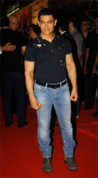 Aamir Khan wore a Paul Smith hand-motif polo shirt with a black