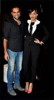 Sonam Kapoor wore a Dolce and Gabbana tuxedo at the event. Coral Christian Louboutin pumps and red lips completed her look. Guess who Sonam Kapoor is hugging!