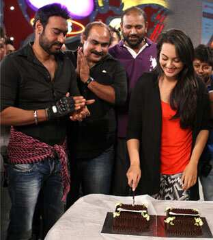 Sonakshi cuts the cake as the SOS team looks on. Sonakshi celebrates birthday on SOS sets