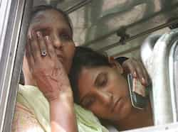 Sarabjit's younger daughter Poonam rests her head on her mother's shoulder as she wipes off a tear while on their way to Jalandhar. (Munish Byala/HT Photo) A tale of two prisoners