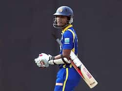 Sri Lankan cricketer Dinesh Chandimal walks back to the pavilion after his dismissal during the third one day international (ODI) match between Sri Lanka and India at the R.Premadasa Cricket Stadium in Colombo. AFP/Lakruwan Wanniarachchi 3rd ODI: India beat Sri Lanka