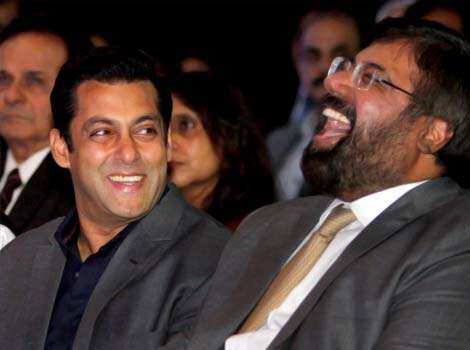 Salman Khan shares a hearty laugh.  SPOTTED! Salman, Nargis at an awards function