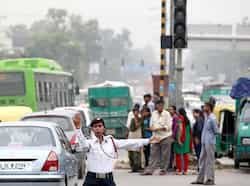 A traffic police officer directs traffic at an intersection during a power outage near Delhi University in New Delhi. HT/Raj K Raj North, East India powerless