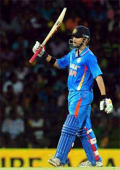 Indian cricketer Gautam Gambhir raises his bat after scoring a half-century (50 runs) during the third one day international (ODI) match between Sri Lanka and India at the R. Premadasa Cricket Stadium in Colombo. AFP/Lakruwan Wanniarachchi 3rd ODI: India beat Sri Lanka