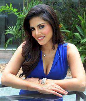 Sunny Leone flaunts ample cleavage in a blue dress with plunging neckline (Photo: PTI). ELECTRIC BLUE-UTY: Sunny Leone
