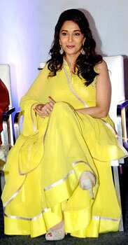 Bollywood beauty Madhuri Dixit makes a bright appearance in a yellow attire for the launch of Its Only Cinema magazine in Mumbai on July 14. SUNSHINE BEAUTY! Madhuri Dixit at an event
