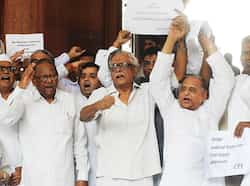 Opposition members of Parliament shout slogans as Samajwadi Party president Mulayam Singh Yadav (2R) leads an eight party combination of non-UPA and NDA MPs during a sit-in demonstration at the main gate of Parliament house in New Delhi. AFP/Raveendran Day in pics