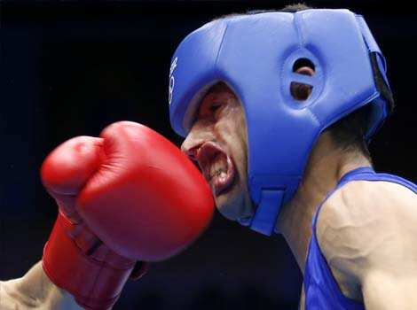 Nordine Oubaali of France (L) fights against Afghanistan