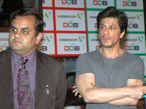 Anirudh Dhoot, Director of Videocon along with Actor and Brand Ambassador Shah Rukh Khan addressing the press conference during launch the Digital Direct Broadcast DDB, the advanced TV technology in Mumbai. WHY SO SERIOUS? Shah Rukh Khan