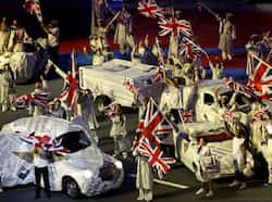 Performers wave Union Jack flags during the closing ceremony of the London 2012 Olympic Games at the Olympic Stadium. (Reuters/Fabrizio Bensch) Olympics 2012: Closing Ceremony