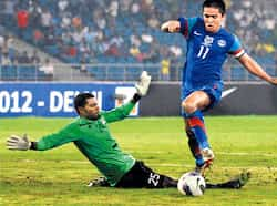 Sunil Chhetri goes past the Maldives goalkeeper during their Nehru Cup match on Saturday. He hit the goalpost on this occasion, but his brace helped India win easily. Virendra Singh gosain/HT photo Aug 26: Day in pics