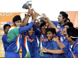 Indian cricket team celebrates with the trophy after winning the U19 cricket World Cup at the Tony Ireland Stadium in Townsville, Australia. (PTI Photo/ICC) India U-19 World champs