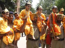 Policemen with children dressed as Lord Krishna in Amritsar on Thursday. (Munish Byala/HT) Region in pics