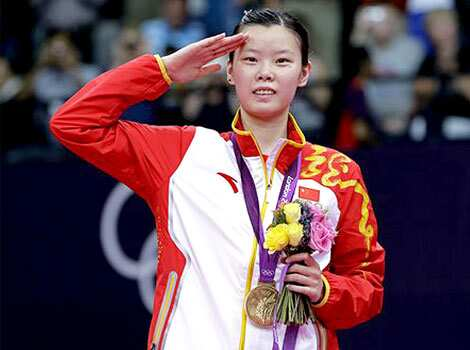 Gold medalist Li Xuerui, of China, salutes from the podium of the women