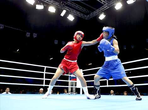 Maroua Rahali of Tunisia fights MC Mary Kom during their quarterfinal Women