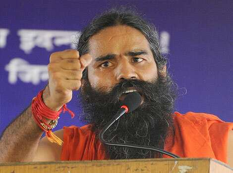 Yoga guru Baba Ramdev address his supporters during  a protest in New Delhi. (AFP Photo/Raveendran) Day 2: Ramdev