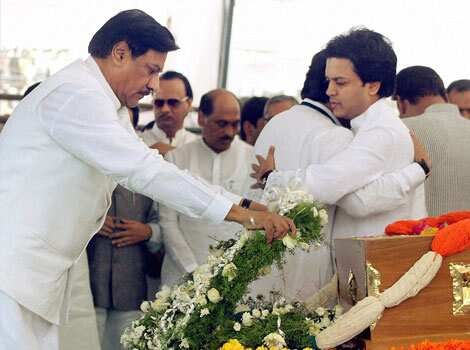 Maharashtra chief minister Prithviraj Chavan paying his last respect to the mortal remains of union minister Vilasrao Deshmukh during his funeral at Babhalgaon in Latur. PTI photo Remembering Vilasrao Deshmukh