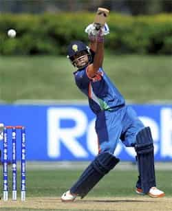 Prashant Chopra of India drives down the ground during their ICC U19 Cricket World Cup 2012 semi final match against New Zealand at Tony Ireland Stadium in Townsville, Australia. PTI photo Aug 23: Day in pics