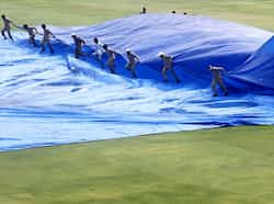 Groundsmen remove a raincover from the field after a rain delay during the third day of the first test cricket match between India and New Zealand in Hyderabad.Reuters/Vivek Prakash Day 3: India vs New Zealand