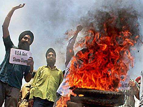 Sikh youths burning tyres and shouting slogans during a protest in Jammu on Monday against the shooting incident at a gurdwara in Wisconsin (US). (PTI photo Region in pics