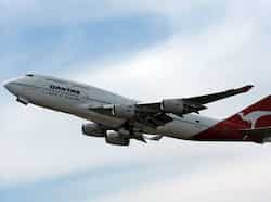 A Qantas passenger plane takes off from Sydney International Airport. Australian flag carrier Qantas Airways on August 23 posted a full-year net loss of $256 million due to high fuel prices and industrial disputes. (AFP Photo) Aug 23: Day in pics