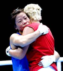 MC Mary Kom embraces Maroua Rahali of Tunisia after defeating her in their quarterfinal Women