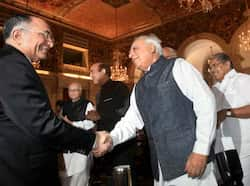 Union HRD minister Kapil Sibal shakes hands with former Chief Justice SH Kapadia during the swearing-in ceremony of the new Chief Justice of India Justice Altamas Kabir at Rashtrapati Bhavan in New Delhi. PTI/Manvender Vashist Justice Kabir is new CJI
