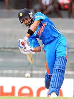 Virat Kohli plays a shot during a World Twenty20 warm-up match between India and Pakistan in Colombo. AFP /Lakruwan Wanniarachchi ICC T20 warm-up: Pak beat India