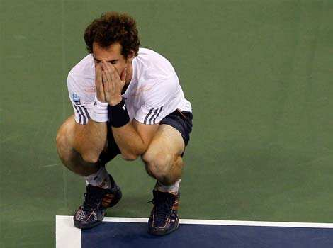 Andy Murray of Great Britain celebrates after defeating Serbia