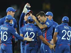 Jade Dernbach celebrates with teammates after he dismissed unseen Afghan batsman Shafiqullah Shafaq during the ICC Twenty20 Cricket World Cup match between England and Afghanistan at the R Premadasa Stadium in Colombo. AFP/Lakruwan Wanniarachchi WC T20: England beat Afghanistan