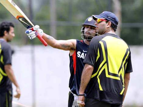 Yuvraj Singh and Virat Kohli during practice session ahead of T20 cricket match between India and New Zealand in Visakhapatnam. HT Photo/Ashok Nath Dey Team India practice in Visakhapatnam
