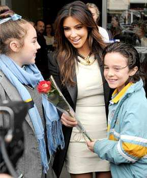 Kim Kardashian receives a flower from a 10-year-old boy Conrad Noonan-Barros as his sister Helena, 13, watches outside a radio station in Melbourne, Australia. AP/Mal Fairclough Sept 21: Day in pics