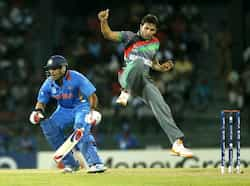 Yuvraj Singh, left, tries to run between wickets as Afghanistan