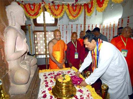 Sri Lankan President Mahinda Rajapaksa offering prayers at Sanchi Stupa in Madhya Pradesh. PTI Photo Rajapaksa in India