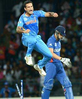 Irfan Pathan (L) celebrates after he dismissed England cricketer Alex Hales (R) during the ICC Twenty20 Cricket World Cup match between India and England at the R Premadasa Stadium in Colombo. AFP Photo/Ishara S.Kodikara WC T20: India beat England