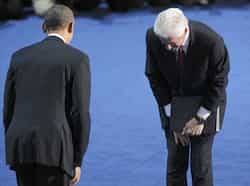 Former President Bill Clinton bows to President Barack Obama after Clinton nominated Obama for re-election during the second session of the Democratic National Convention in Charlotte, North Carolina. Reuters/Jonathan Ernst Bill Clinton bats for Obama