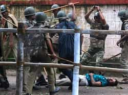 A demonstrator beaten by policemen during a violent protest in Bhubaneswar. (AFP photo) Clash outside Odisha assembly