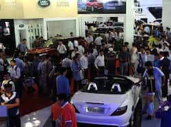 Visitors look at a Mercedes Benz SLK 350 AMG and a Land Rover Range Rover during the Vietnam Motorshow 2012 being held in Hanoi. AFP/Hoang Dinh Nam The beautiful beast