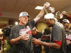 Jay Bruce #32 and Aroldis Chapman #54 of the Cincinnati Reds celebrate a National League Central Division Championship during the game against the Los Angeles Dodgers at Great American Ball Park. AFP/Getty Images/John Grieshop Sept 23: Day in pics