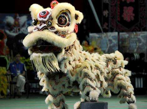 Italian team members perform a lion dance during the world championships in Hong Kong. A total of eight teams take part in the lion dance which is a form of traditional dance in Chinese culture, in which performers mimic a lion
