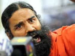 Baba Ramdev addresses a press conference in New Delhi. AFP Photo/Raveendran Day in pics