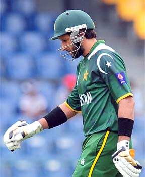Shahid Afridi reacts after being dismissed by Ravichandran Ashwin during the World T20 warm-up match between India and Pakistan in Colombo. AFP/Lakruwan Wanniarachchi ICC T20 warm-up: Pak beat India